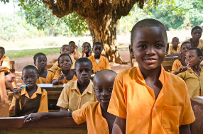 A school in Ghana held under the trees